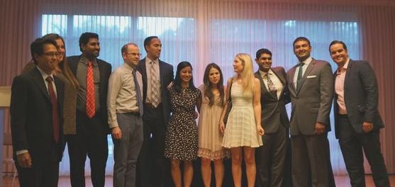Residents gather on stage at the 2015 Department of Psychiatry Housestaff Graduation at the Gainesville Woman's Club